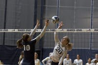 SUPER SPIKE: Kaisa Newberg '22 leaps high over the net to spike the ball against Case Western Reserve University on Sept. 30.