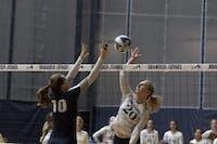SUPER SPIKE: Kaisa Newberg '22 leaps high over the net to spike the ball against Case Western Reserve University on Sept. 30.