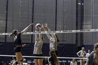BRANDEIS BLOCK: Shea Decker-Jacoby '19 and Kaisa Newberg '22 block a spike from Case Western on Sept. 30th.
