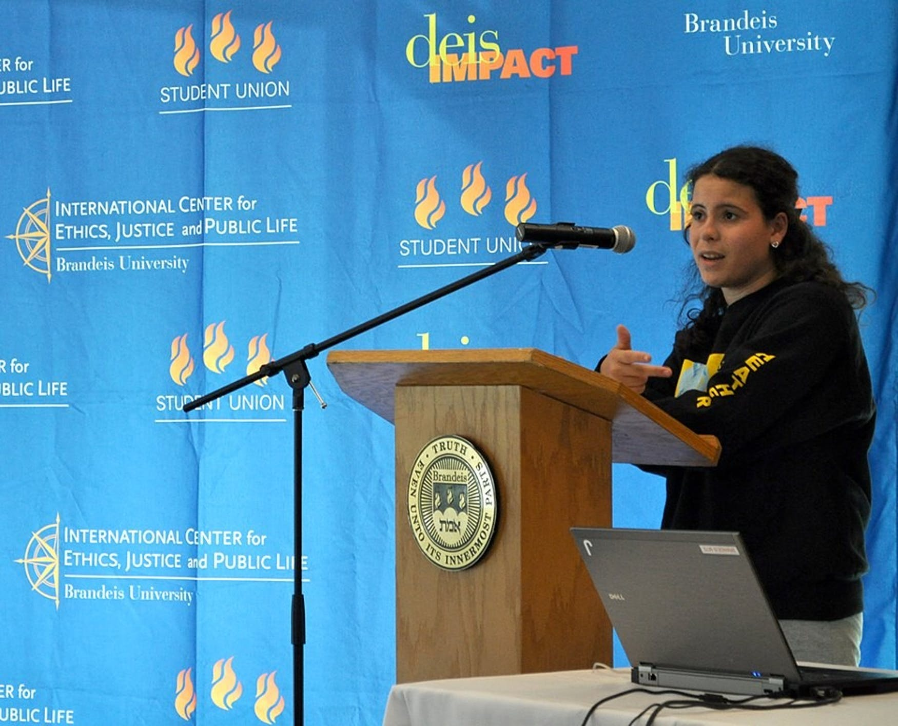 SPEAK TRUTH TO POWER: Heather Spector '17 takes the podium at last year's 'DEIS Impact festival of social justice.