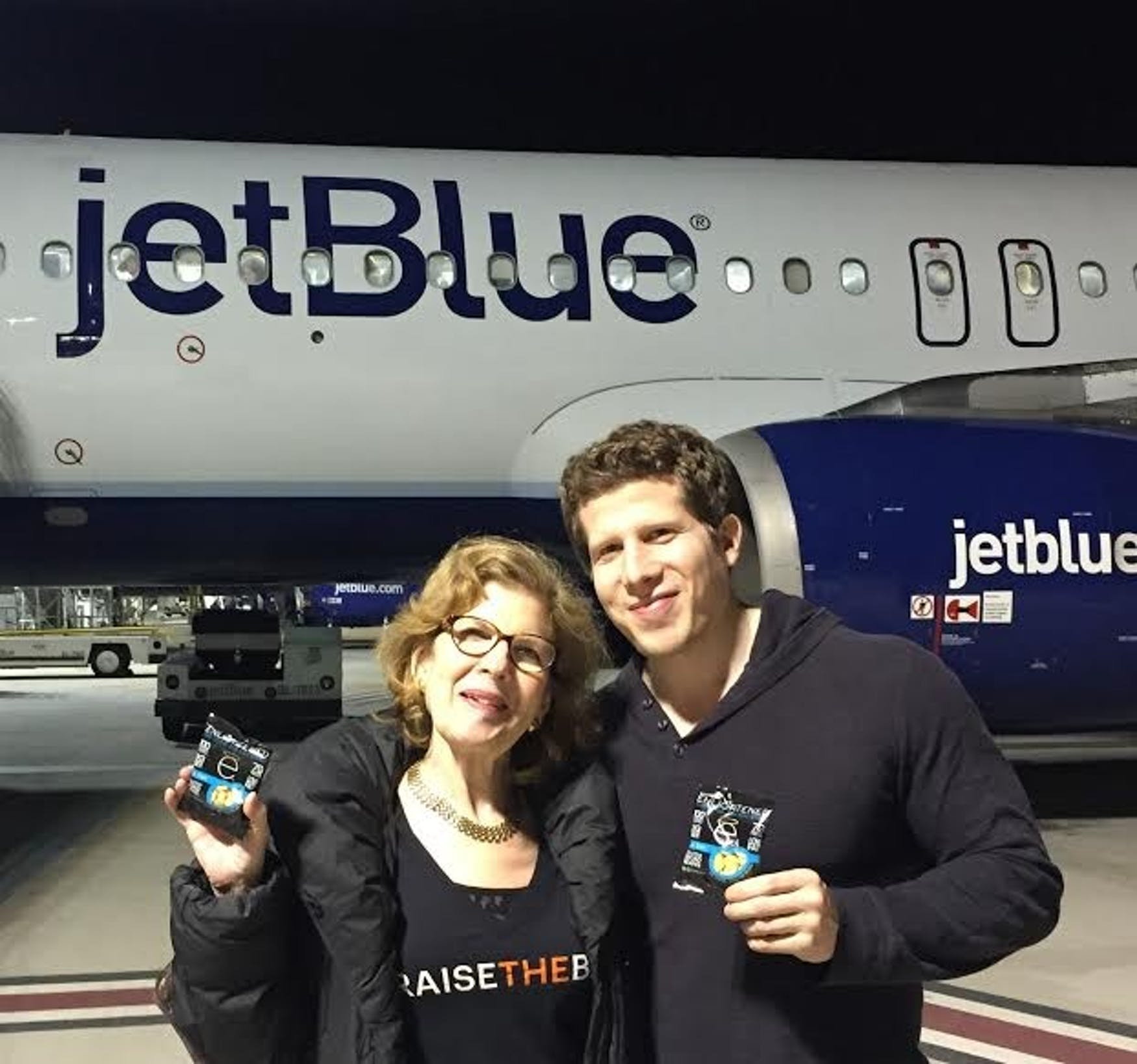 FAMILY: Carol Ann Finkelstein, Shoretz's mother and president of Beyond Better Foods, stands with Shoretz by the first airplane to carry ENLIGHTENED Crisps.