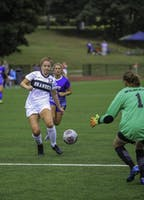 FANCY FOOTWORK: Midfielder Becca Buchman '19 attempts to shoot the ball past the Johnson and Wales Goalkeeper on Sept 8.