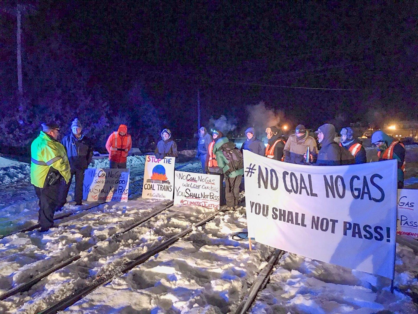 2019-12-08_No Coal No Gas banner & Ayer Police Sgt. John MacDonald.jpg