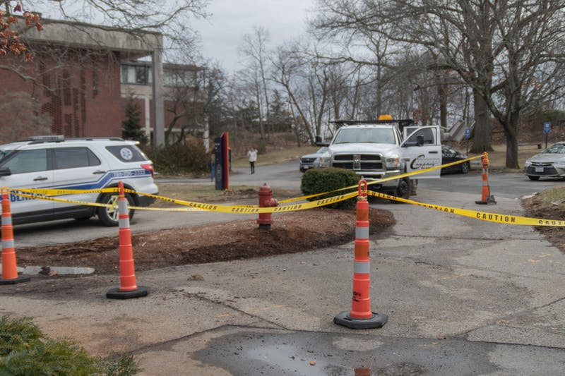 WATER HAZARD: Paths around Pearlman Hall were taped off when damage to a control valve caused water leakage.