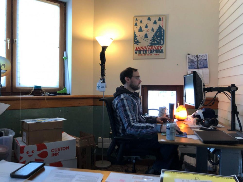 """<span class=""""photocreditinline"""">SABINE POUX/THE MIDDLEBURY CAMPUS</span><br />Assistant director of student activities David Kloepfer, pictured in his McCullough office."""