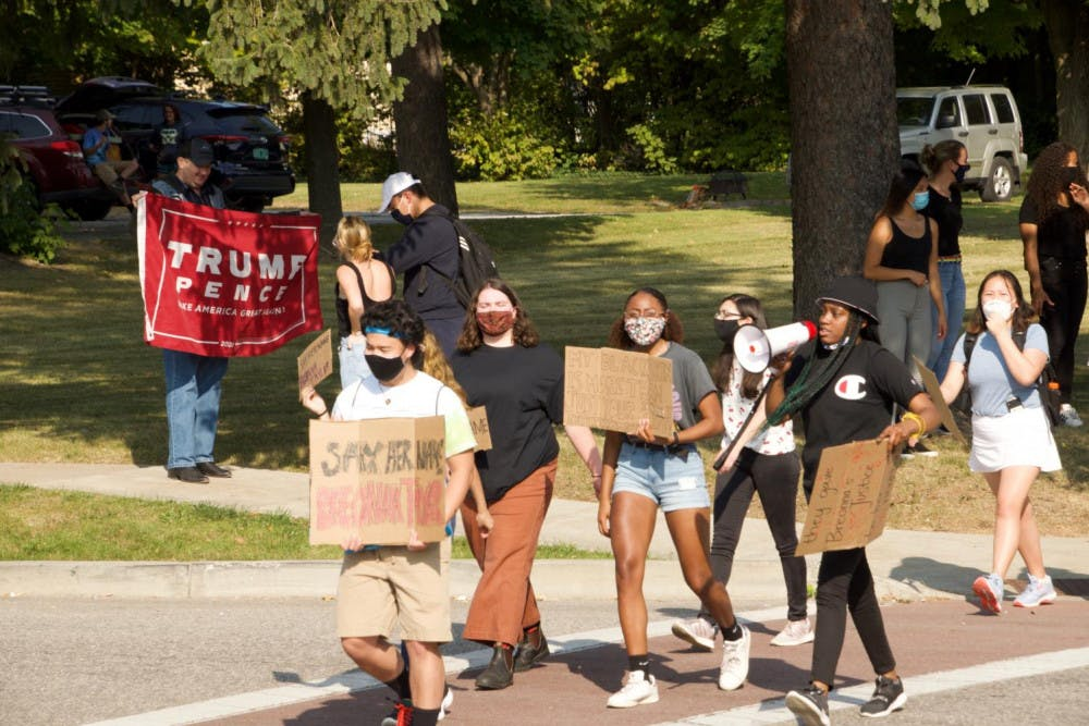 """<span class=""""photocreditinline""""><a href=""""https://middleburycampus.com/staff_profile/van-barth/"""">Van Barth</a></span><br />Students marched in September after it was announced that the police officers who shot and killed Breonna Taylor would not be charged with her death."""