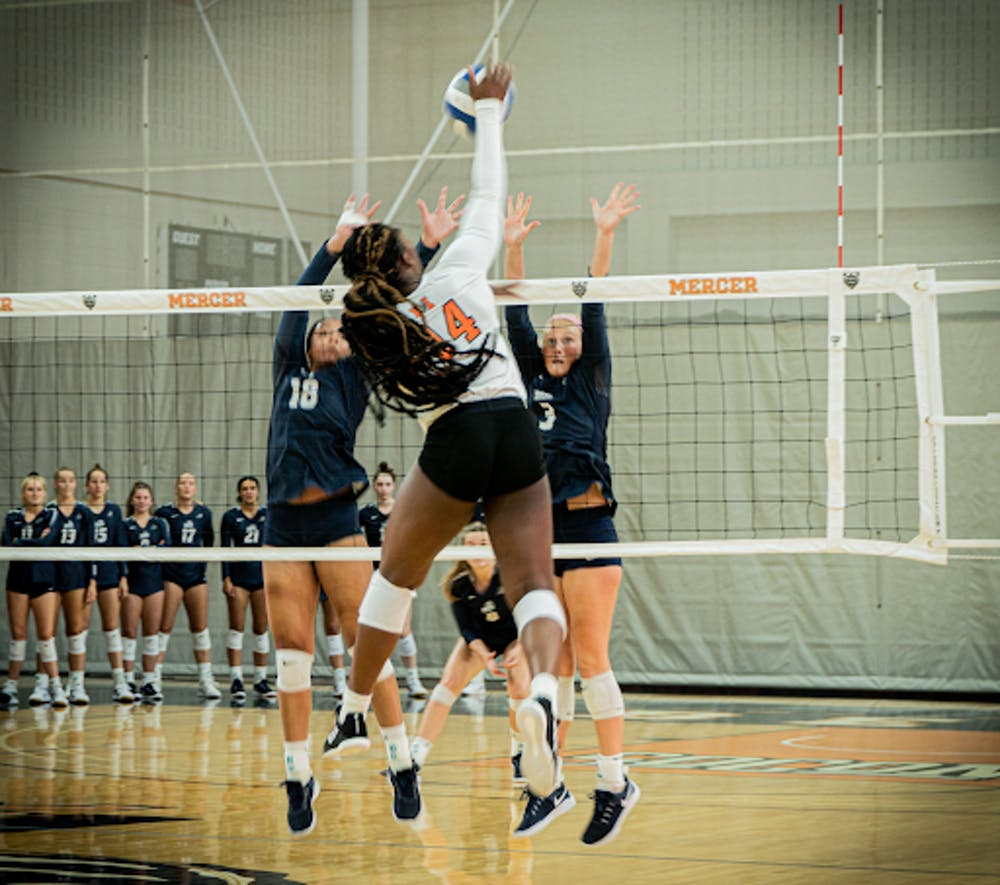 <p>Senior Brittany Major spikes the ball at the top of the net over Georgia Southern blockers.</p><p><strong><br/><br/><br/></strong></p>