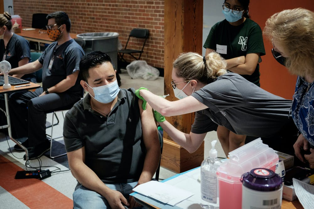 An attendee receives a COVID-19 vaccine at a clinic the Faith in the Vaccine Ambassadors helped to organize for the local Hispanic community in July. Photo provided by the Mercer Office of Marketing Communications.
