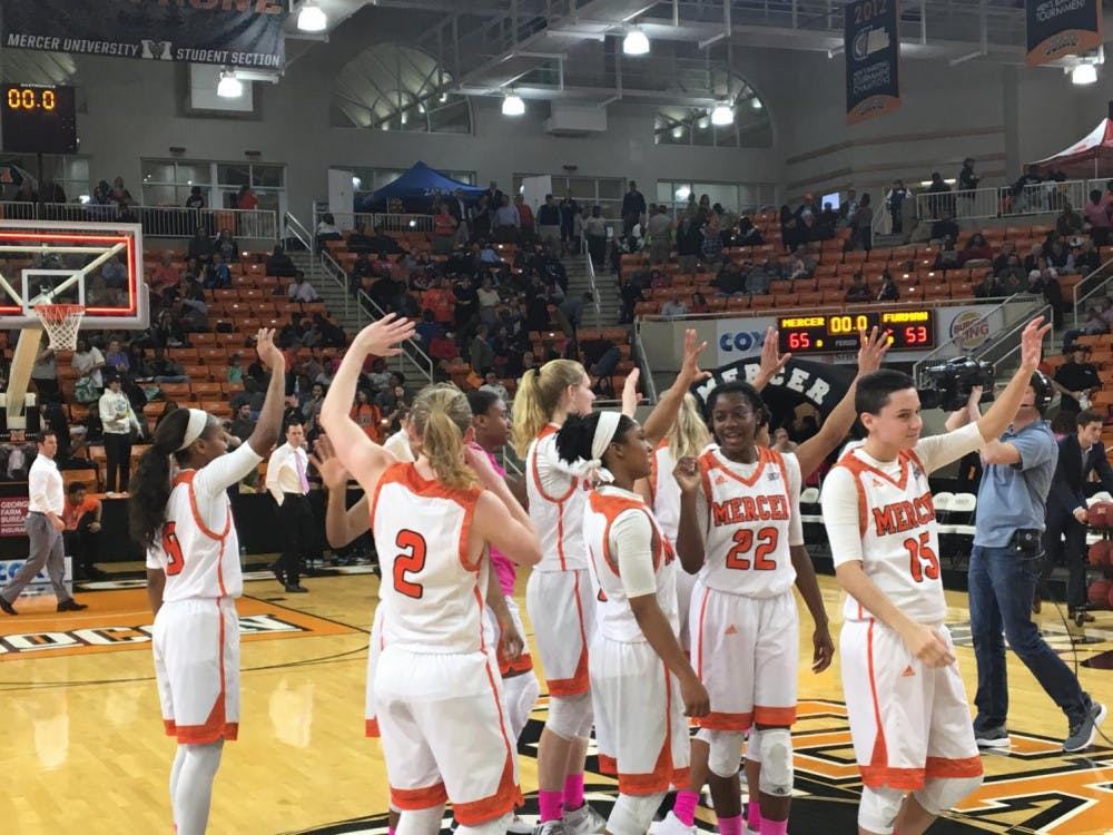 The Women's Basketball team celebrating after a win over Furman.