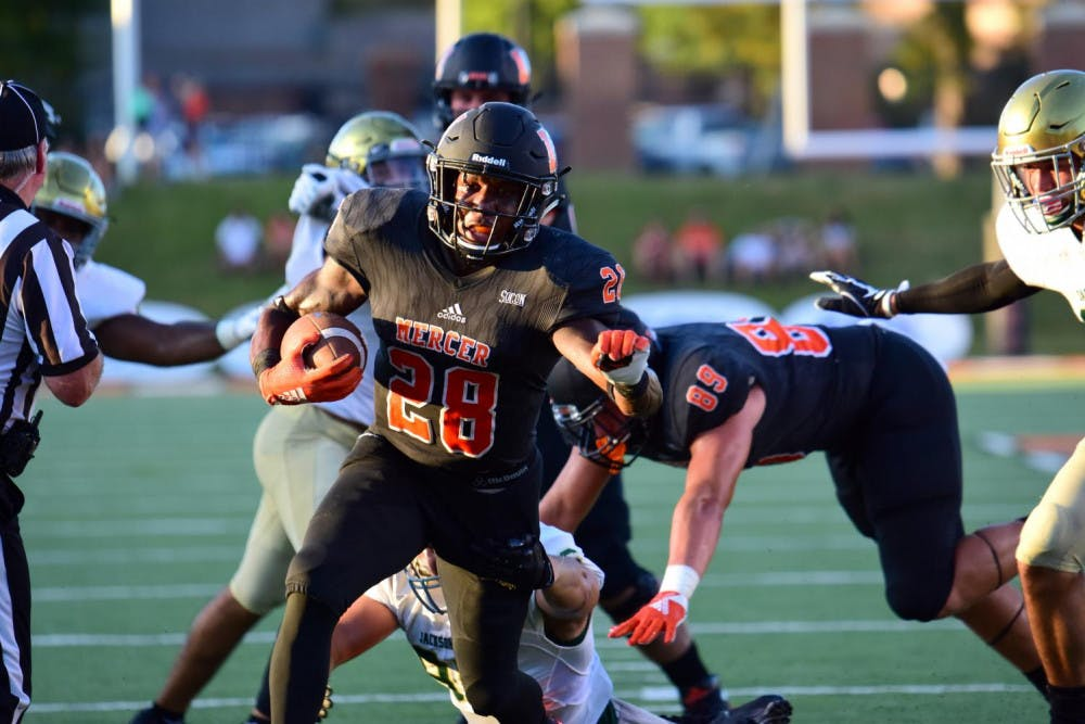 Running back Tee Mitchell rushed 118 yards in game against Jacksonville University. Photo by Mitch Robinson.