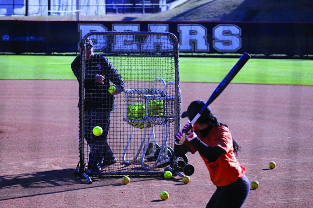 Mercer softball Head Coach Stephanie DeFeo tosses batting practice one week before regular season play is to begin.