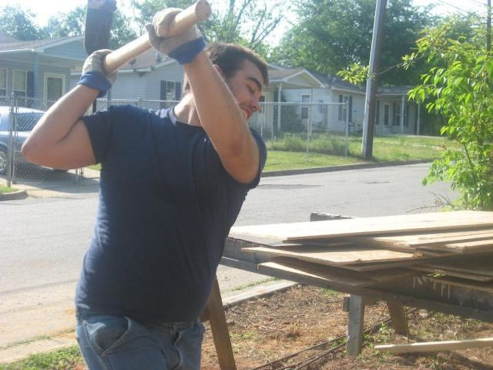Garrett McDowell, junior, works at a build site for Macon Habitat for Humanity. Mercer University Habitat will hold a faculty luncheon in March to raise money for the next build.