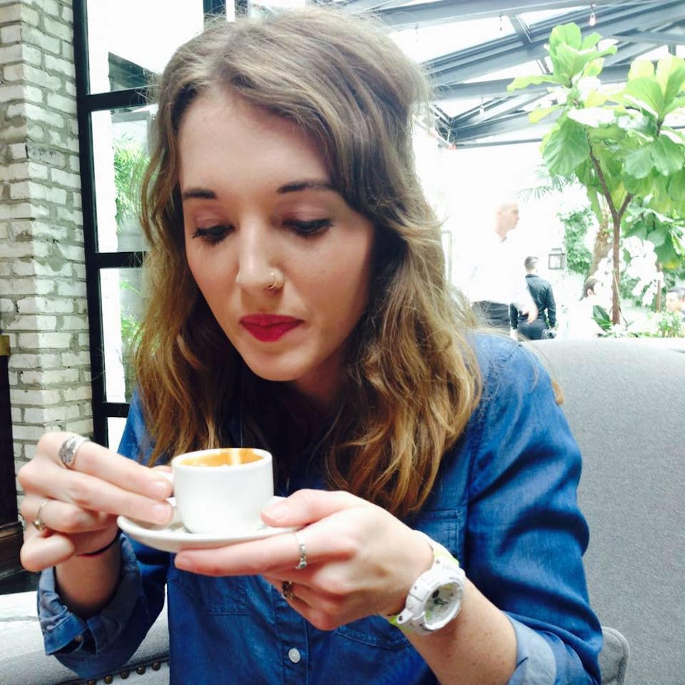 Conner Wood, The Cluster's editor in chief, enjoys a small coffee at a restaurant in Tampa, Florida.