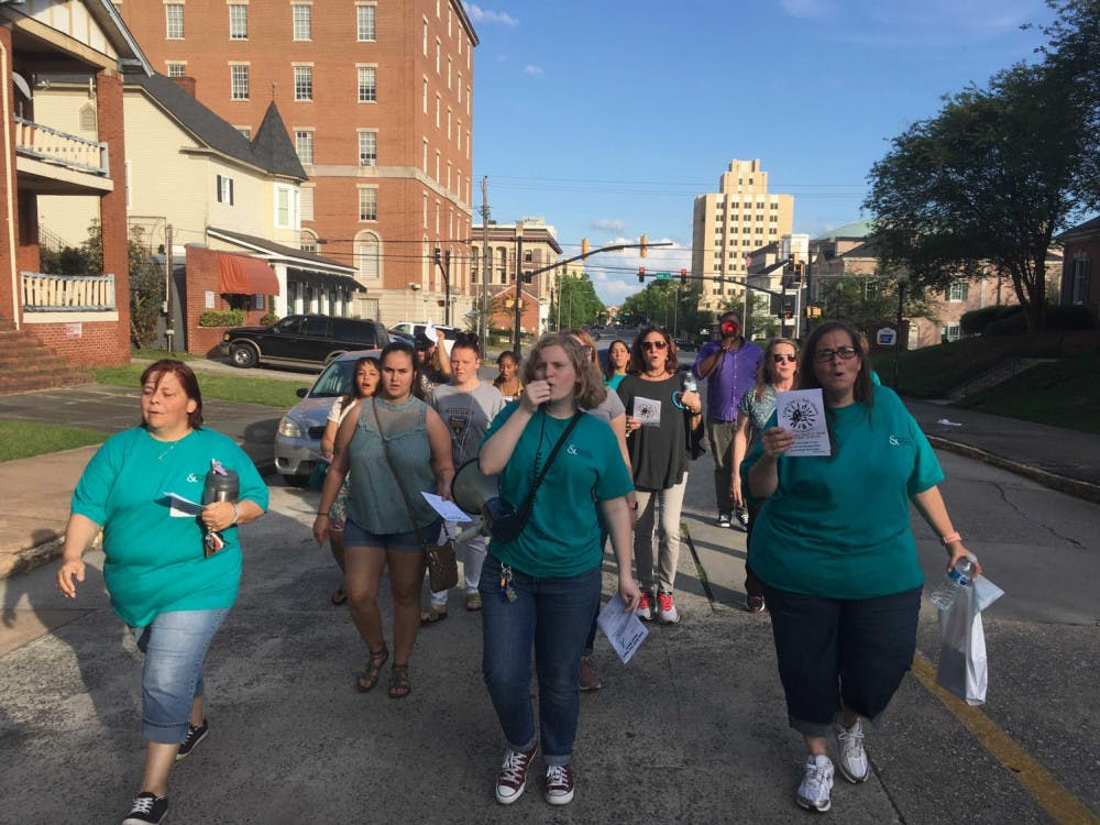 Mercer senior Emma Johnston helps lead a domestic violence prevention walk with Crisis Line and Safe House in April 2019. Archived photo provided by Emma Johnston
