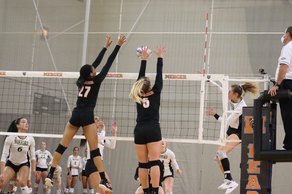 <p>Mercer&#x27;s setter Agnieska Paskevic (#5) and middle hitter Jaida Howell (#27) rising to block Wofford&#x27;s spike attempt. </p>