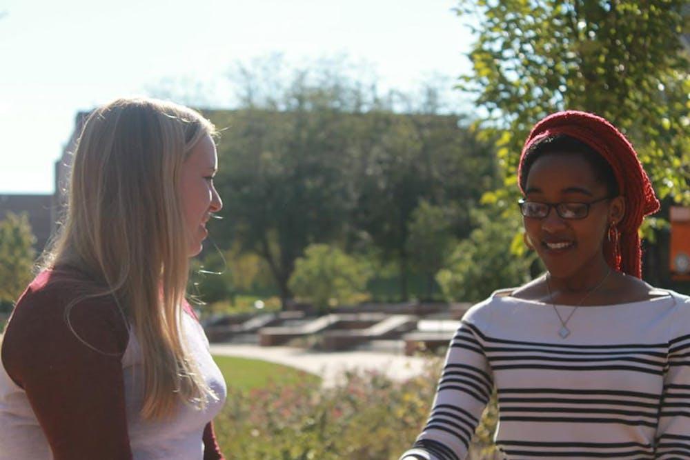 Summer Perritt Interviewing international student Mhpo Molapo by Cruz Plaza.