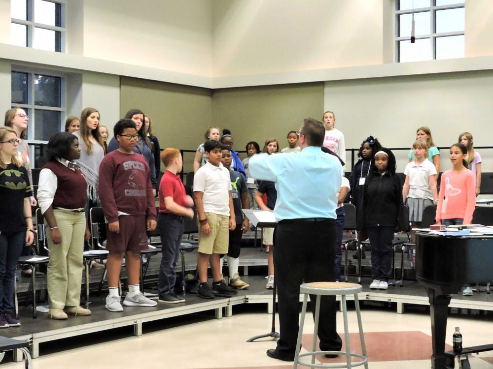 Dr. Kosowski conducting the MU Choir during a practice in the Mercer Music Building.