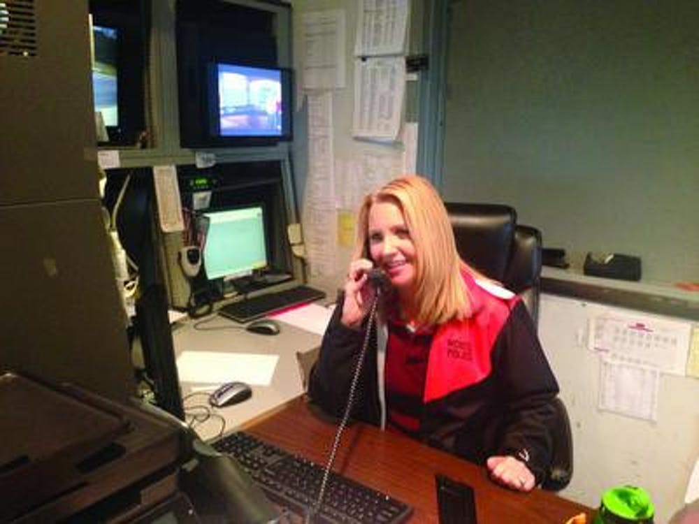 Tonia Wilkes, who works dispatcher for Mercer Police, answers the phone to handle a student complaint. She said she tries to maintain a calm and soft tone whenever she answers the phone.