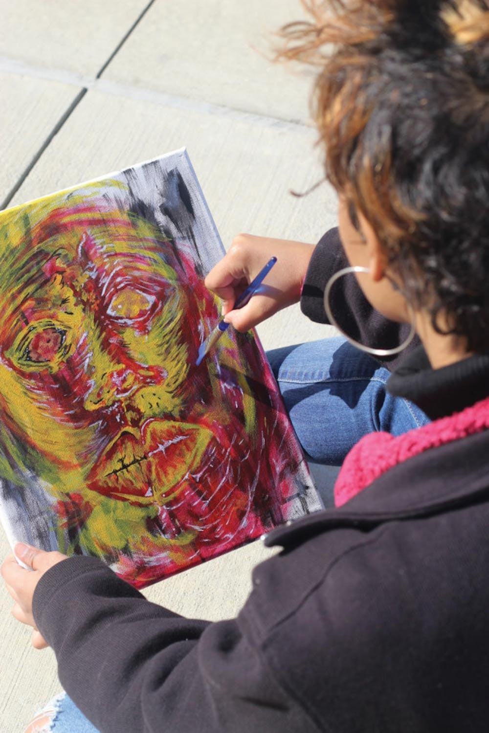 A student works on a painting.