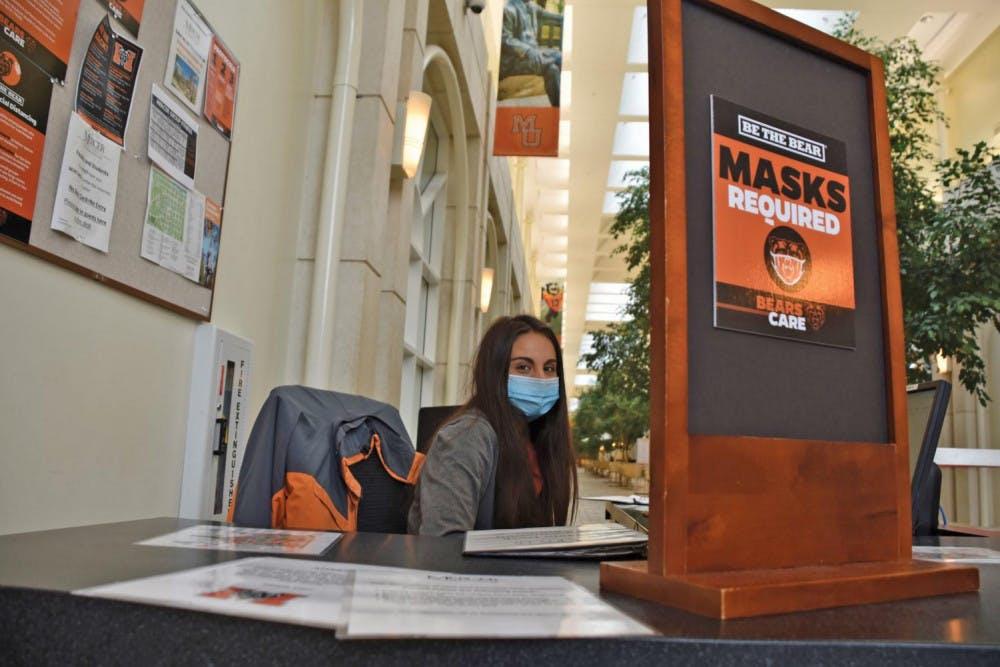Lucia Gutierrez wears a mask in the University Center.