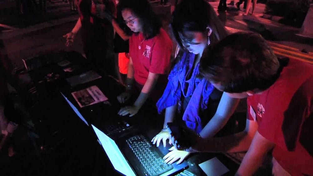 """Students signing up to vote at last semester's """"Turn Out to Vote"""" event to encourage student voter participation."""