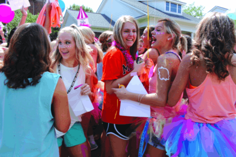 Phi Mu sisters yell and laugh when they see their new sisters. Photo by Katie Atkinson.