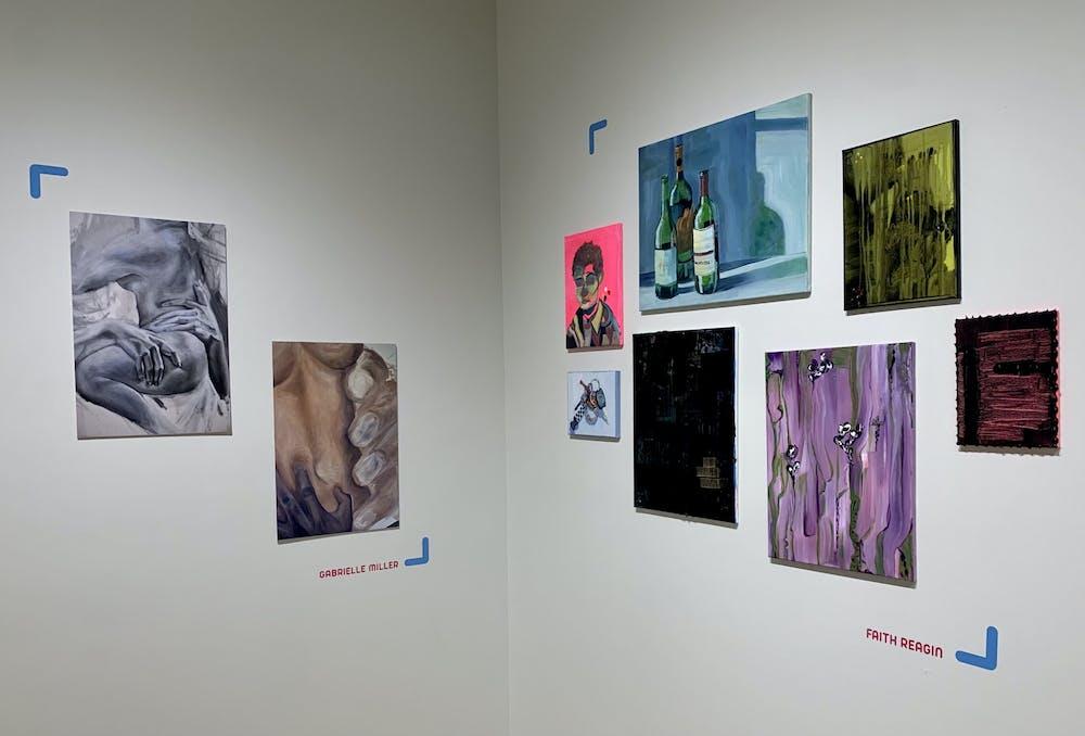 A corner of the Summer Salon art show featuring Gabrielle Miller's and Faith Reagin's artwork.