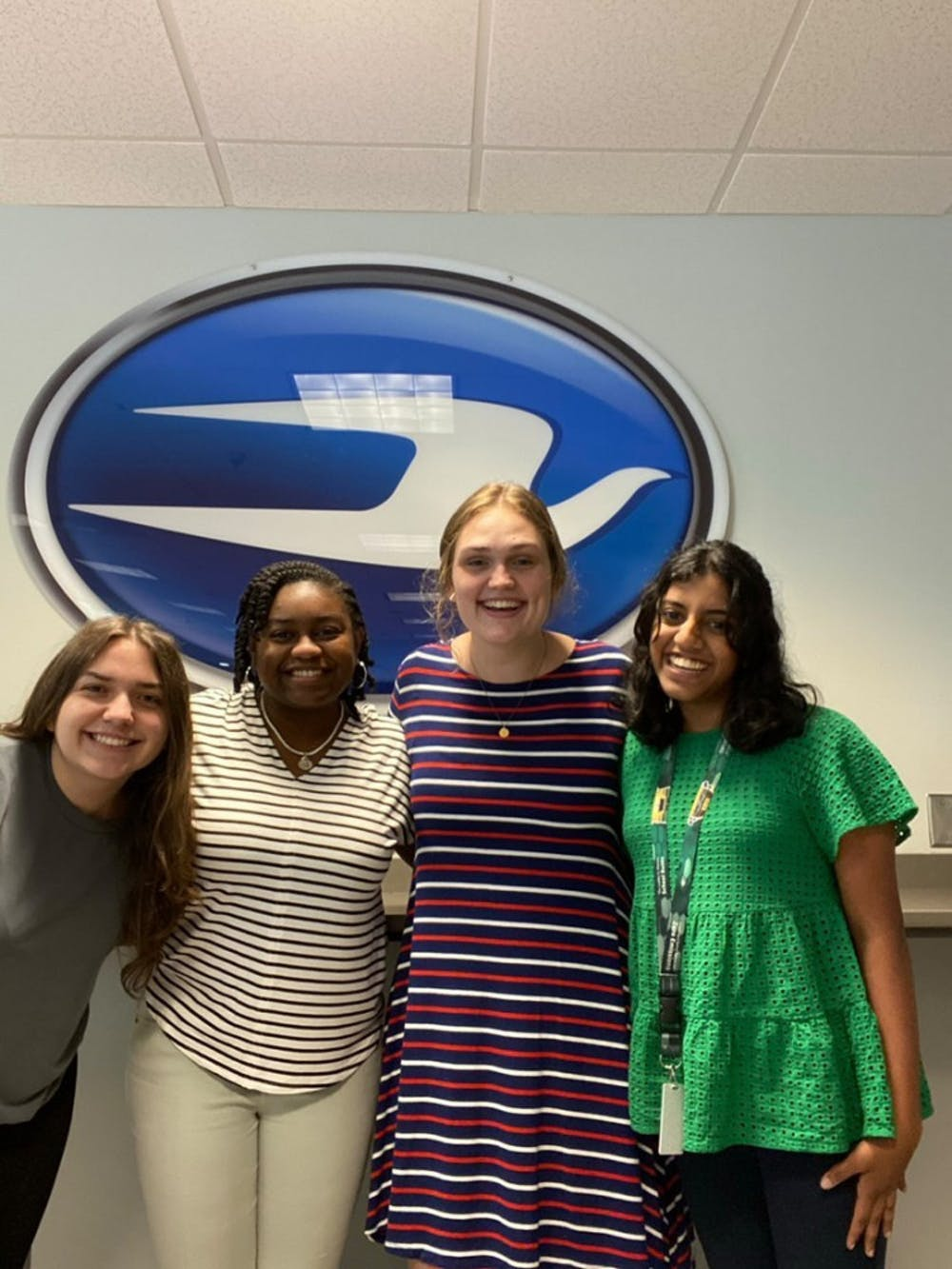 (Left to right) Kimberly Lopez, Asia Cladd, Christianne Grist and Hannah Jeevanayagam  posing at their internship with Blue Bird. The four of them are just a few of the Mercer students who worked at the bus manufacturer this summer. Photo provided by Hannah Jeevanayagam.