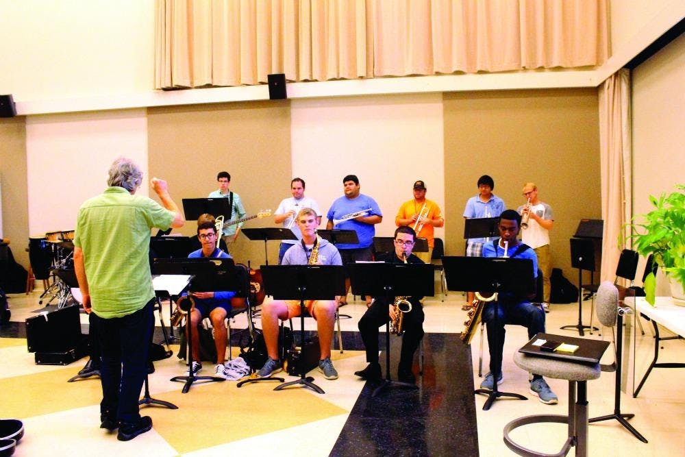 As the concert draws near the jazz band practice with intensity to get every note right.