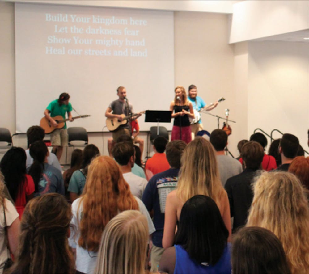 Students gather at the Christian Organization Welcome (COW) Party for a time of worship and fellowship