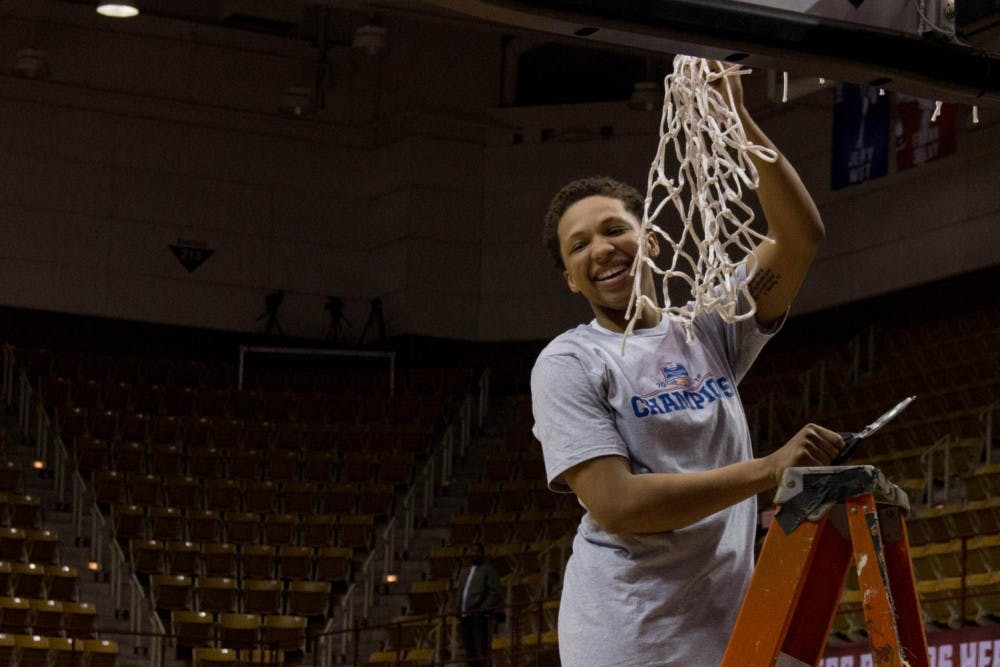 Kahlia Lawrence holds up the net at the end of the SoCon Championship game. Lawrence was awarded the Most Outstanding Player Award. She ended the tournament with 75 points in three games while shooting a scorching 60 percent from the field.