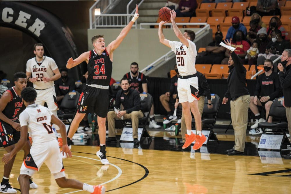 Mercer's Ross Cummings (#20) shoots over Samford's A.J. Stanton-McCray (#5). Cummings would make the shot to go toward his game high, 25 points, which propelled Mercer to an 89 to 82 victory over Samford in double overtime Feb. 8.