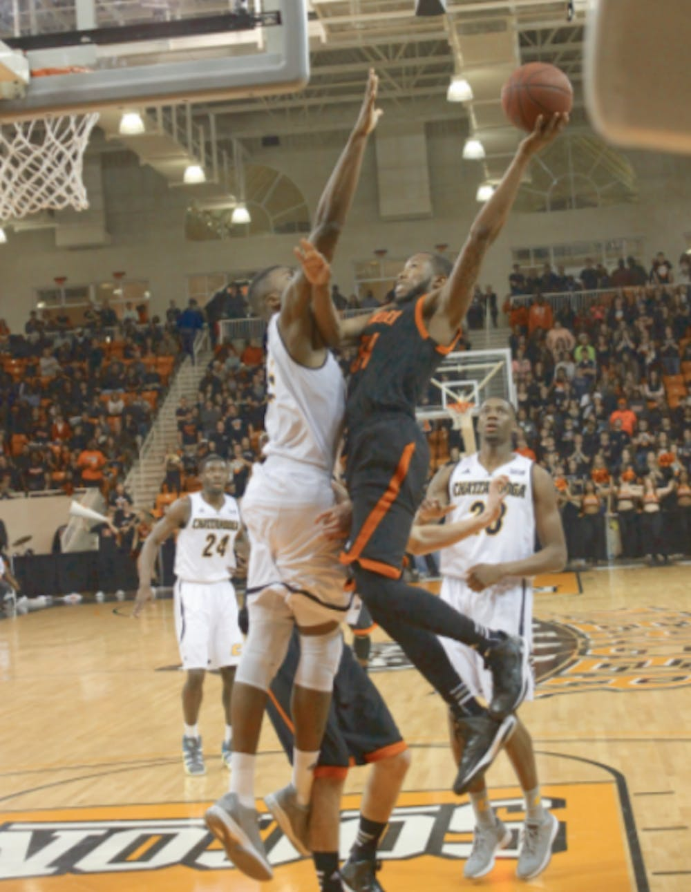 Jibri Bryan goes up against a defender in the Bears' game against the Chattanooga Mocs, February 2015.