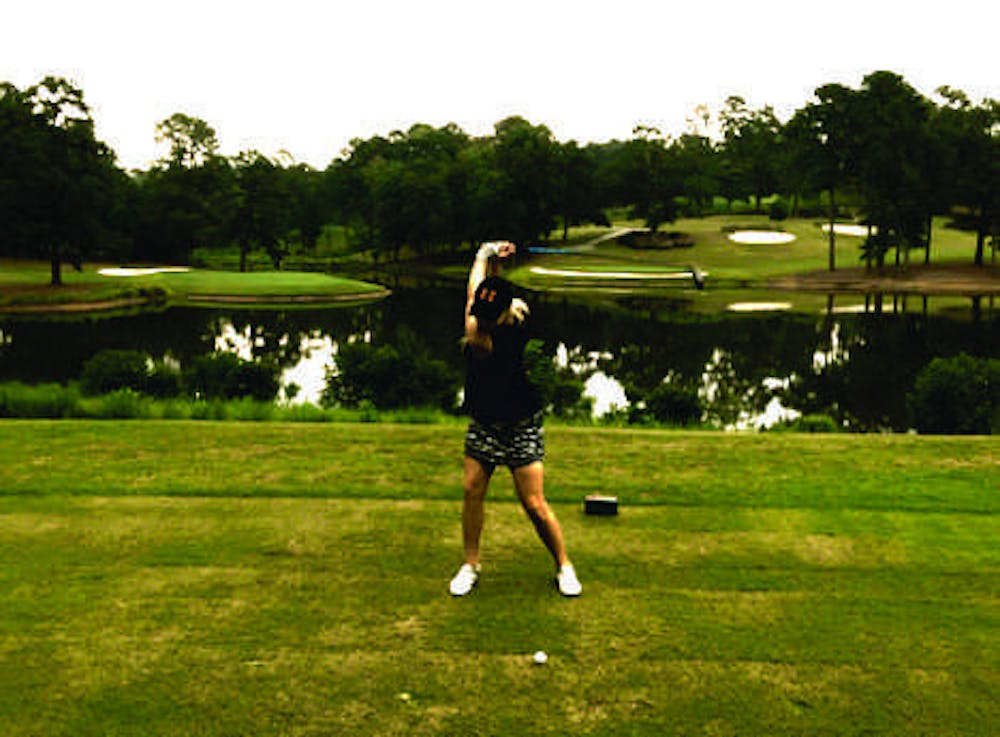Freshman Lauren Lightfritz hitting the ball golf ball as she went on to finish first among her teammates in their first tournament.