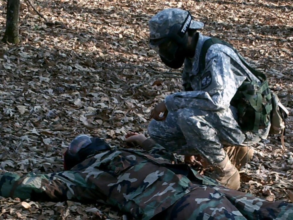A Mercer cadet demonstrates first aid on a volunteer. Mercer's ROTC program arranged an event to encourage interest for high schoolers pursuing military careers after graduation.