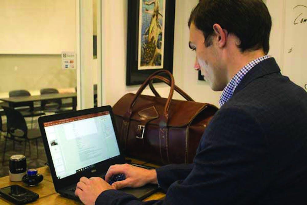 Luke Kolbie works on a project for Entrepreneurship class.
