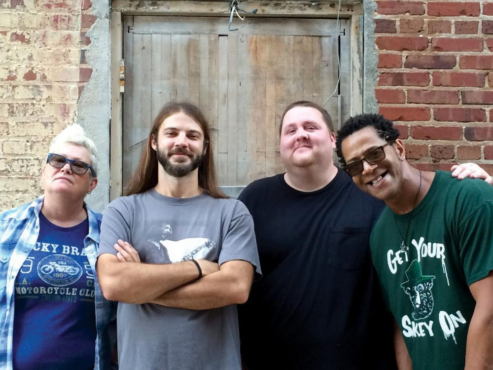Royal Johnson members Andy Johnson (guitar and vocals), Chance Royal (guitar), Kevin Vines (bass and vocals), and Joanie Ferguson (drums and vocals) take photo for Belly Full album release.