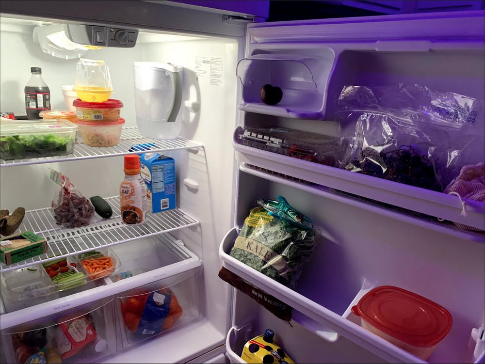 Ashley Pemberton's neurodivergent-proofed fridge, with condiments in the bottom left drawer and perishables on the shelves.