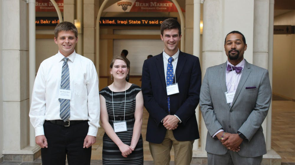 Students who presented at the Phi Alpha Theta Honor Society conference are listed  from left to right: Daniel Garrett (LaGrange), Hannah Keller (Mercer), Kevin Morris  (Georgia College & State) and Professor Maurice Hobson (Georgia State).