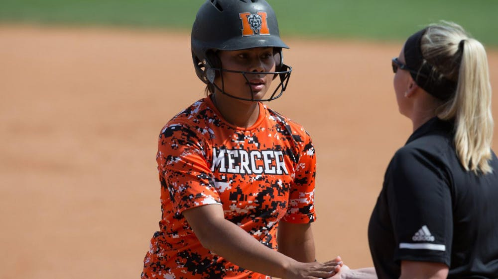 Quires Mauga makes one of Mercer's three hits in game 1 v. UNCG.