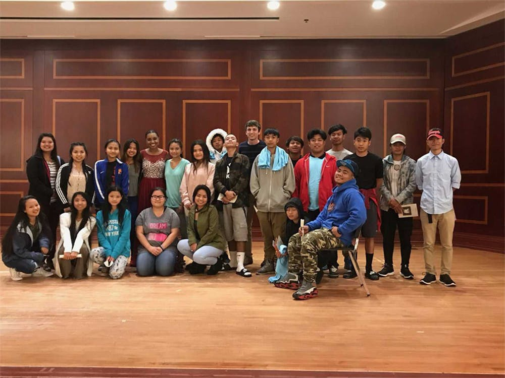 """Sophie Leveille stands with a group of refugees from Jubilee who performed in """"Stateless: Unity, Hope, and Dreams of the Future,"""" the benefit concert at Mercer's Fickling Music Hall last Wednesday that benefitted Jubilee and Leveille's music-education program."""