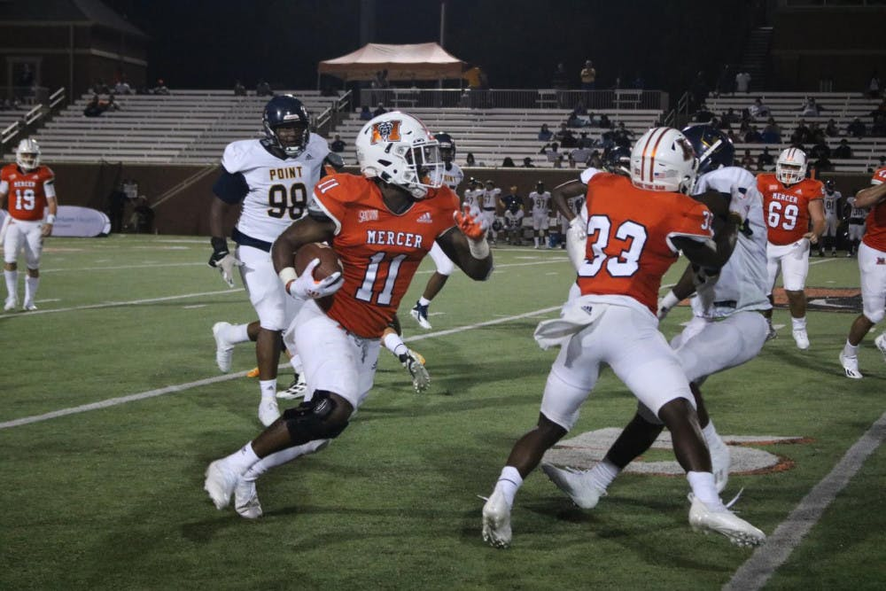 Mercer running back Brandon Mays (#11) bursts to the outside on a rushing play. Mays would end the day with four rushes for a total of 44 yards.