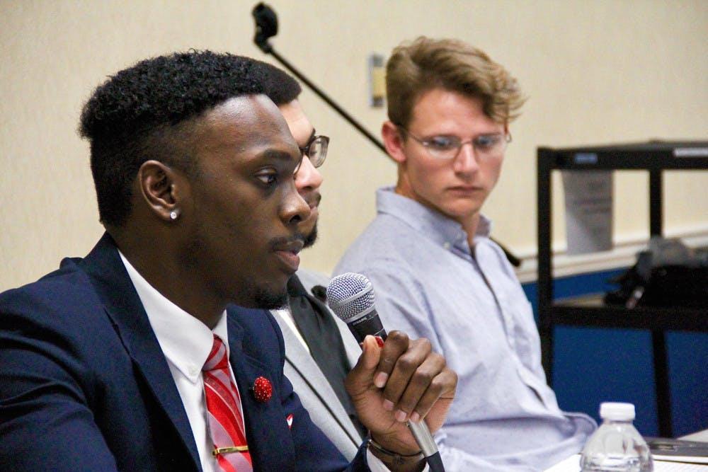 Nnamdi Onyekwuluje, president of the Organization of Black Students, speaks on the peace panel.