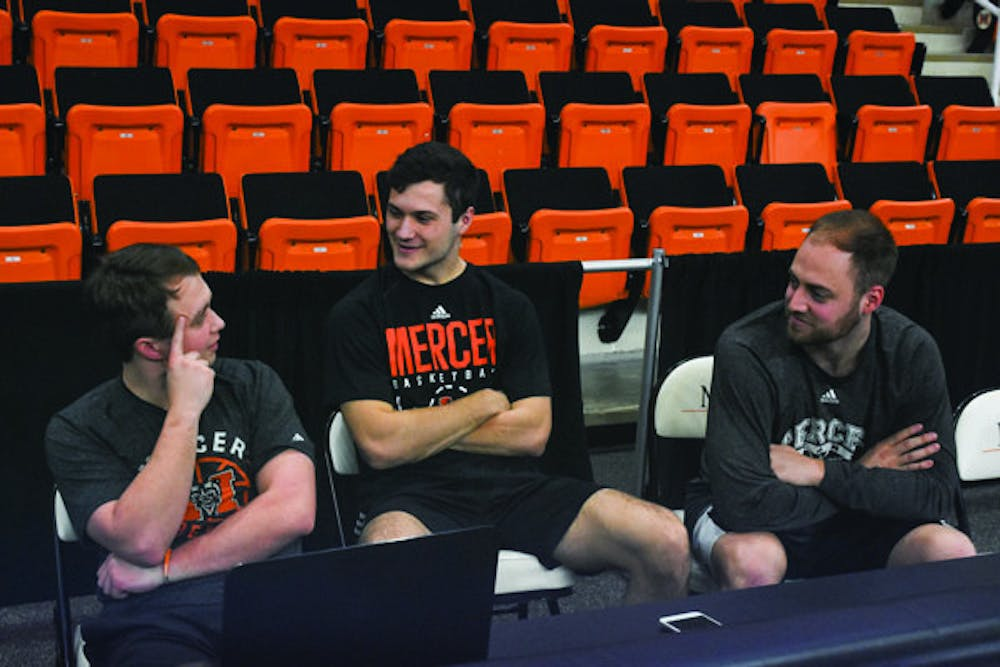 From left to right, Hayden Hatfield, Evan Stair, and James Bento discuss the origins of the Mercer Managers basketball team.