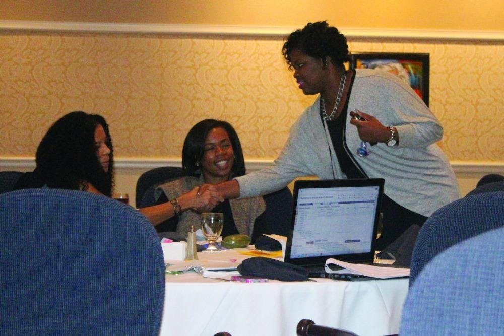 The attendees at the Bearly a Democracy symposium get interactive as they meet new people.