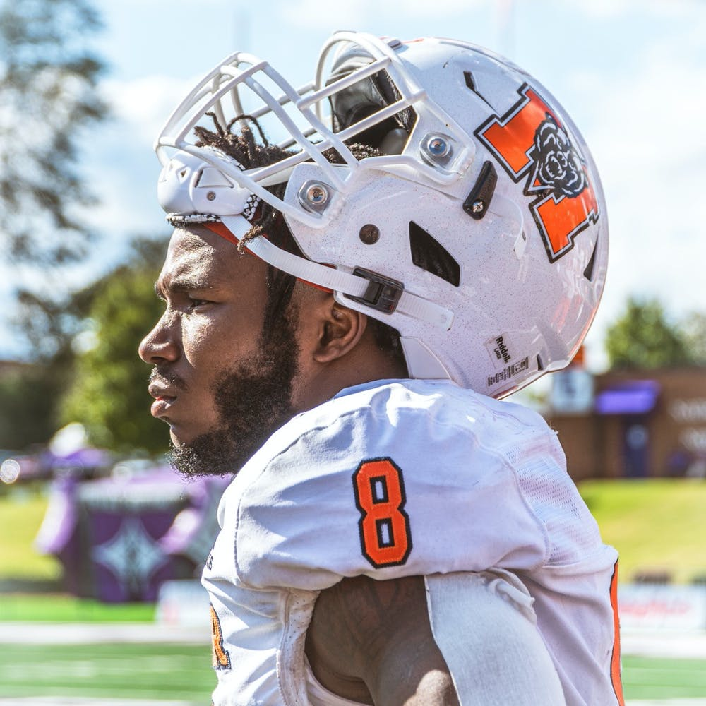 <p>Brandon Marshall admiring the game from the sidelines. Marshall finished the day with 66 rushing yards and two touchdowns during a Mercer 24 Furman 3 victory.</p>