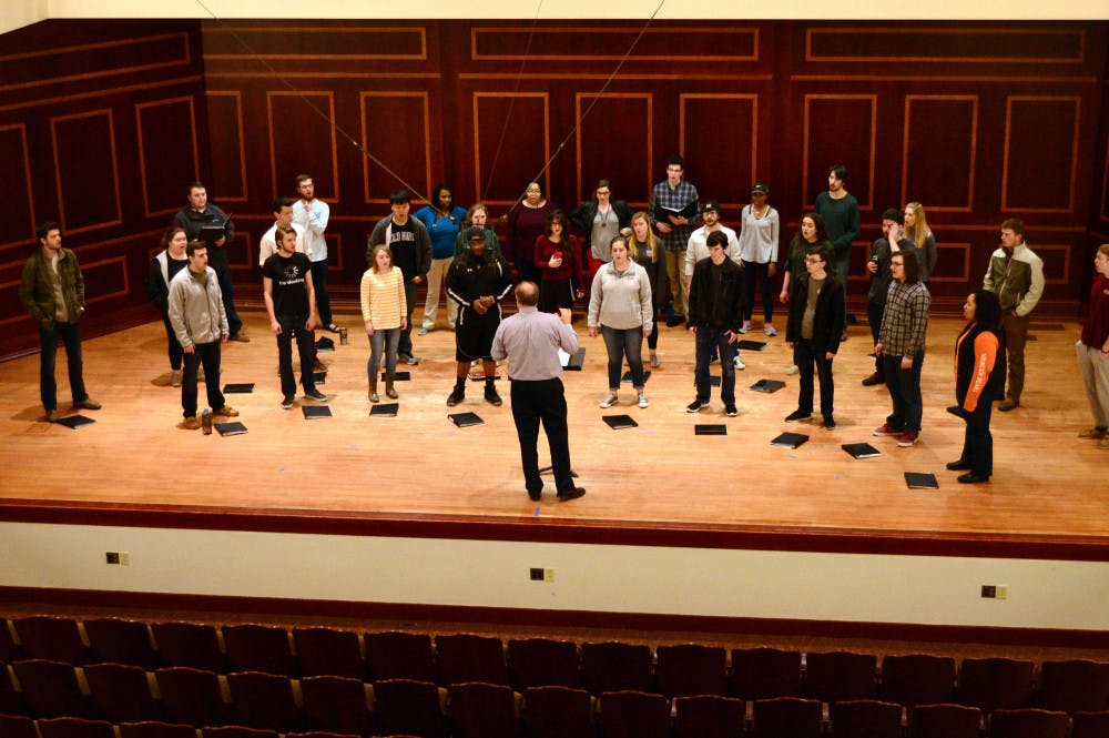 Mercer Singers rehearse for upcoming concert.