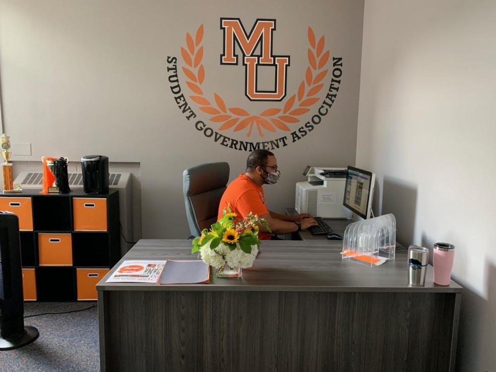 Rylan Allen, Mercer's 2021-2022 SGA president, works in the newly remodeled SGA office in the Connell Student Center.