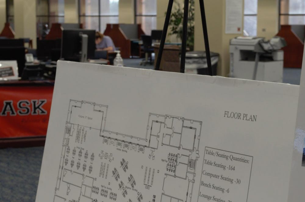 A poster shows the floor plan of the renovated Jack Tarver Library.