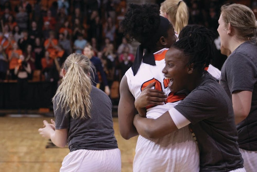 The Bears celebrate after their 67-44 victory over the Mocs.